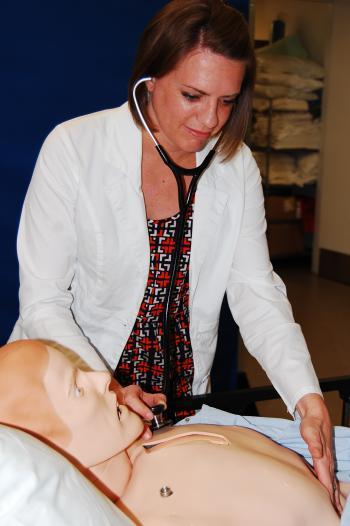 ASU alum Jessica Burns with medical mannequin
