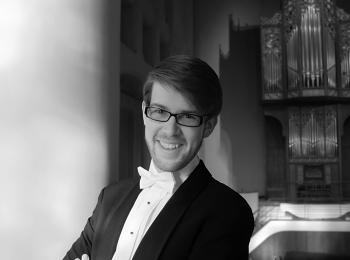 black and white portrait of ASU grad Jonathan Gregoire in a tuxedo