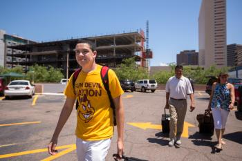 Joey Ramos-Mata walks toward his dorm.