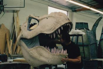 Special effects artist Michael Trcic works on a T. rex
