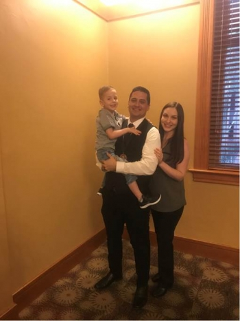 ASU online student Justin Sanchez (middle) with his family.
