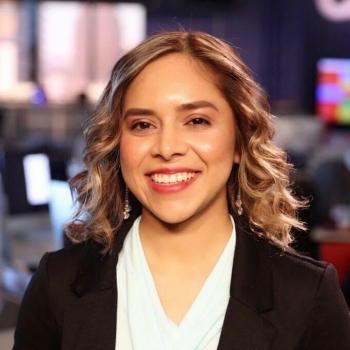 ASU grad Karina Espinoza in a newsroom