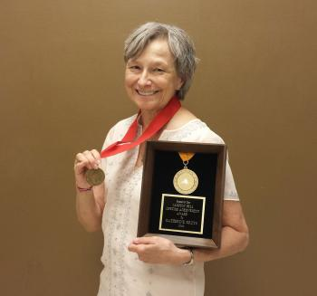 ASU Libraries archivist Katherine Krzys with her Childrens Theatre Foundation of America Corey Medallion and the Campton Bell Lifetime Achievement Award