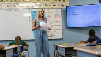 Kiley Cronin teaching in her classroom in front of kids at desks