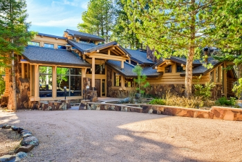A large log home sits among the Ponderosa pines near Payson.