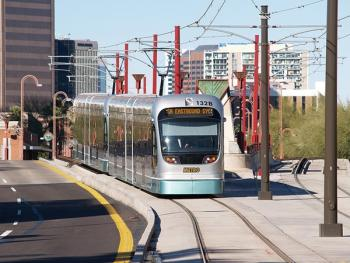 A light rail train travels south along Central Avenue in Phoenix