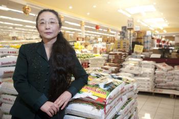 portrait of Wei Li in supermarket