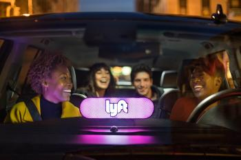 People ride in a Lyft car