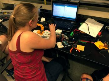 student creating a time-lapse camera