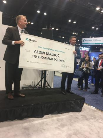 man accepting giant check
