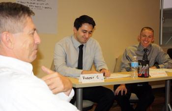 Tom Manos with ASU students Robert Celeya and Jared McDaniel