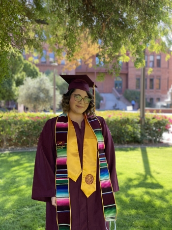 Marlene Ortega ASU grad in her cap and gown and Hispanic Convocation stole