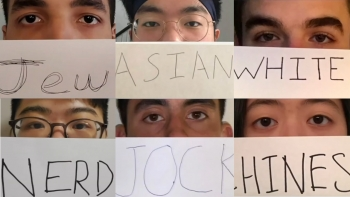 Students holding labels in front of their faces