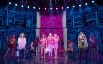 The cast of the Broadway musical Mean Girls stands onstage.