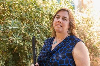 ASU grad Melody Taylor poses at ASU's Tempe campus