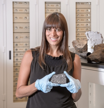 School of Earth and Space Exploration Director Meenakshi Wadhwa holds a meteorite