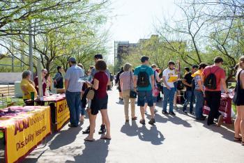 students visiting booths at ASU fair