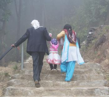 A Nepali family takes an afternoon walk.