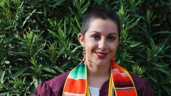 Nicole Haikalis poses in her graduation attire.