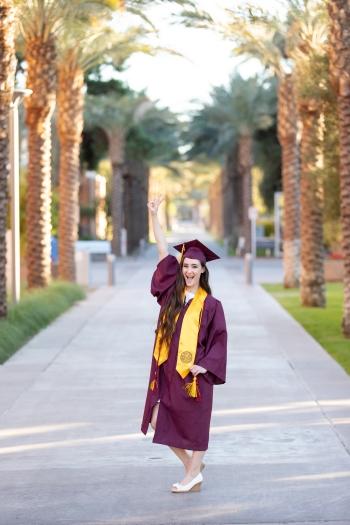 Nicole Waldmann stands along Palm Walk