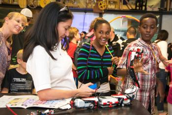 Visitors at Night of the Open Door on the Polytechnic campus tour ASU labs and participate in hands-on activities organized by Fulton Schools faculty and students. Photographer: Nick Narducci