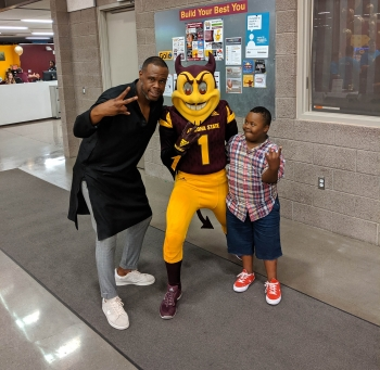 Nakia Gorden and his son show their Sun Devil pride and pitchforks with Sparky