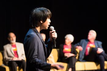 student speaking in microphone