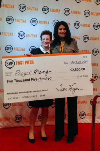 two women holding a check at SVP Fast Pitch competition
