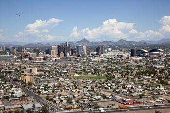 aerial image of downtown Phoenix, Arizona with flying airplane