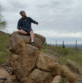 ASU Polytechnic campus English graduate Marshal Meador outdoors in the Sonoran desert