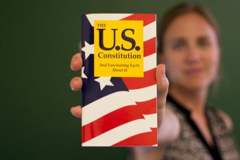 woman holding pocket US Consititution