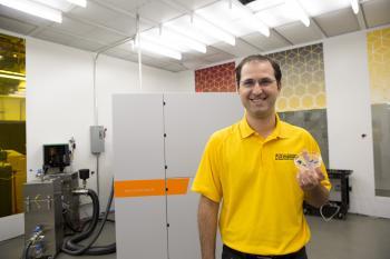 Bruno Azeredo displays optical gratings used in microscopes and spectrophotometers.