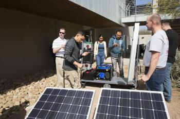 people working with solar panel
