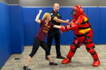 Photo of ASU Police officer and participant in women's self-defense course