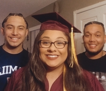 Raelene Vasquez stands with family