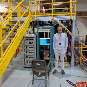 Glenn Randall stands next to ONRL equipment key to his thesis research.