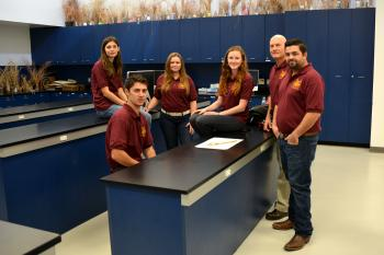 ASU's 2015 Society for Range Management competitors and faculty coach in lab