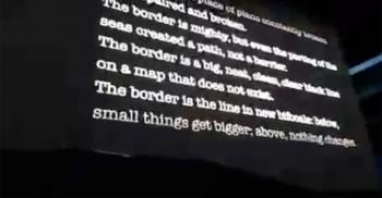 ASU Professor Alberto Rios poem on screen at U2 concert