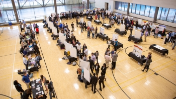 Engineering students and faculty gather for a capstone projects showcase event