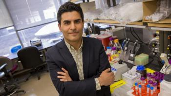 "Portrait of Mehdi Nikkhah in his lab with a caption of ""Assistant Professor Mehdi Nikkhah's vision of a microengineered chip to better understand hear attacks is being rewarded bt the National Science Foundation with a CAREER Award totaling $500,000 over"