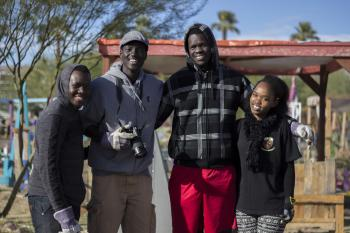 MasterCard scholars pose outside while volunteering together