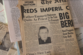 Photo of an old newspaper announcing Emmett McLoughlin had quit the priesthood