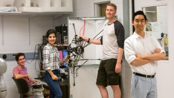 Hyunglae Lee (right) poses with his students in the Neuromuscular Control and Human Robotics Laboratory