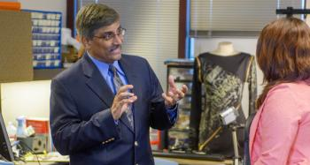 Sethuraman Panchanathan talks with a student in the Center for Cognitive Ubiquitous Computing