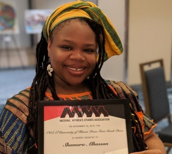 ASU Assistant Professor Shamara Wyllie Alhassan smiling with her book award