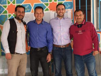 Dr. Shane Dixon with course facilitators at the Za'atari Syrian refugee camp in Jordan.