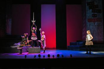 "Actors performing on stage in ""She Kills Monsters"""