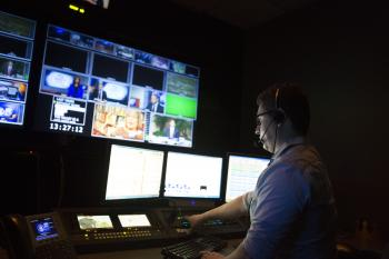 man in broadcast news control room