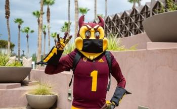 ASU mascot Sparky wearing a mask