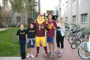 Sparky poses with Talent Match students